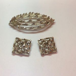 Sparkly silver tone brooch and clip earrings